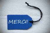 Blue Label With French Text Merci Means Thank You — Stock Photo