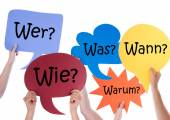 Many Colorful Speech Balloons With German Questions — Stock Photo