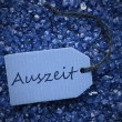 Purple Stones With Label Auszeit Means Downtime — Stock Photo #71625453