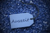 Purple Stones With Label Auszeit Means Downtime — Stock Photo
