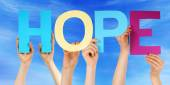 People Hold Colorful Straight Word Hope Blue Sky — Stock Photo
