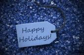 Purple Stones With Label Happy Holidays — Stock Photo