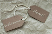 Beige Labels With Welcome Home Paper Background — Stock Photo