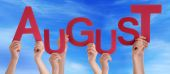 Many People Hands Holding Red Word August Blue Sky — Stock Photo