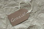 Beige Label With Italian Grazie Means Thank You — Stock Photo