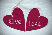 Two Red Hearts With Give Love — Stock Photo