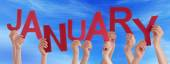 People Hands Holding Red Word January Blue Sky — Stock Photo