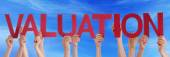 Hands Holding Red Straight Word Valuation Blue Sky — Stock Photo
