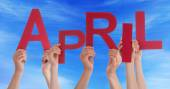 Many People Hands Holding Red Word April Blue Sky — Stock Photo