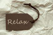 Braun-Etikett mit Relax Papierhintergrund — Stockfoto