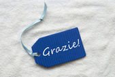 Grazie Means Thank You Blue Label Sand Background — Stock Photo