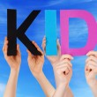 Hands Holding Colorful Straight Word Kid Blue Sky — Stock Photo #76619125