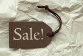 Brown Label With Sale Paper Background — Stock Photo