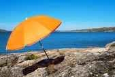 Swedish Coast With Blue Sea And Orange Parasol — Stock Photo