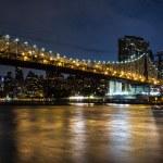 New York by night: Queensboro Bridge, East River and Manhattan — Stock Photo #76110217