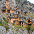 Lycian rock cut tombs carved into the hillside of Myra, Turkey — Stock Photo #58509569