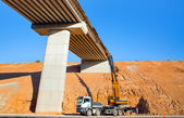 Process of bridge construction to pass through it motorways — Stock Photo