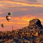 Hot air balloon flying over Cappadocia — Stock Photo #58883477