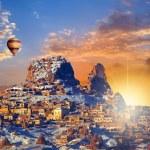 Hot air balloon flying over Cappadocia — Stock Photo #58883537
