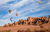 Hot air balloon flying over Cappadocia — Stock Photo