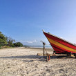 Empty boat on the sandy beach — Stock Photo #56134555