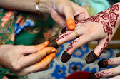 Henna being applied to hand — Stock Photo