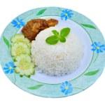 Nasi lemak traditional malaysian spicy rice dish — Stock Photo #56195739
