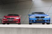 Wet after rain two 640i and 425d front view — Stock Photo
