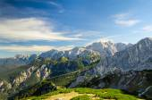 Alps sunlight high mountains peaks with green valley and blue sk — Stock Photo