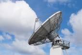Big radar parabolic radio antenna global information data stream — Stock Photo