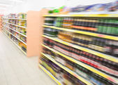 Shelves with beverages bottles in grocery food store in supermar — Stock Photo