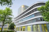 New ADAC Headquarters 18-storey office tower rises above 5-store — Stock Photo