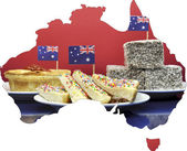 Map of Australia showing traditional Aussie tucker party food, lamingtons, fairy bread and meat pies. — Stock Photo
