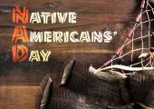 Native Americans Day wood carving style greeting text on dark rustic recycled wood — Stock Photo