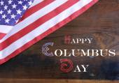 Happy Columbus Day greeting message text on dark rustic recycled wood — Stock Photo
