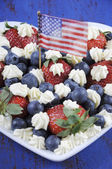 Red white and blue berries with fresh whipped cream stars. — Foto de Stock