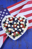 Patriotic red, white and blue berries with fresh whipped cream stars — Stock Photo