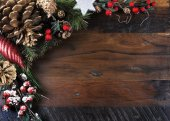 Traditional Christmas background on dark recycled wood. — Stock Photo