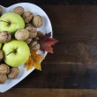 Thanksgiving Harest Apples and Nuts on Heart Shape Plate — Stock Photo #57554673
