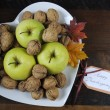 Thanksgiving Harest Apples and Nuts on Heart Shape Plate — Stock Photo #57554859