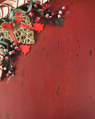 Christmas background with vintage style ornaments on dark red recycled wood. — Stock Photo