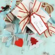 Modern Christmas red and white ornaments on aqua blue vintage wood background. — Photo #58549449