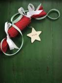Christmas holiday ornaments on dark green wood background — Stock Photo