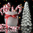 MArry Christmas gift and candy canes with bokeh lights — Stock Photo #59407831