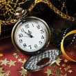 Happy New Year fob pocket watch with minutes to midnight time closeup — Stock Photo #59673265