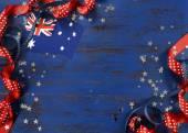 Australia Day background on dark blue wood — Stock Photo
