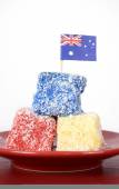 Australia Day red, white and blue lamingtons party food. — Stock Photo