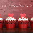 Happy Valentine red velvet cupcakes with love messages on red vi — Stock Photo #62566057
