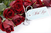 Happy Valentines Day bouquet of red roses on white background. — Stock Photo