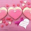 Pink heart shape ladies dresses decorated cookies — Stock Photo #64880451